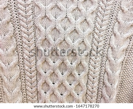 Knitted background. Knitted texture. Knitting pattern of wool. Knitting. Texture of knitted woolen fabric for wallpaper and an abstract background    #1647178270