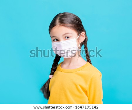 sick Girl child in medical mask isolated on blue background #1647195142