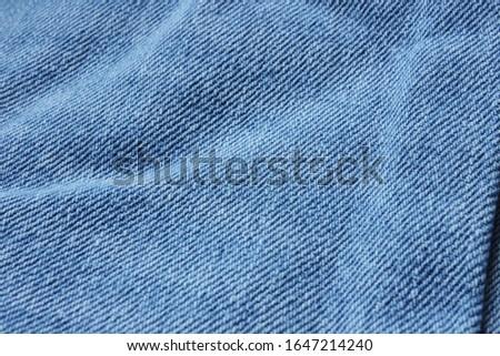 Denim blue fabric close-up. Denim texture. Denim jeans texture or denim jeans background. #1647214240
