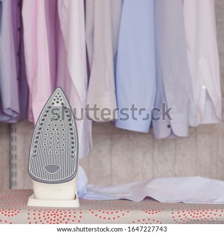 ironed items and iron on ironing board #1647227743