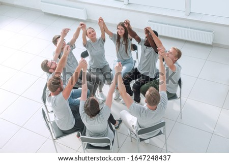 group of young people joining their hands together #1647248437