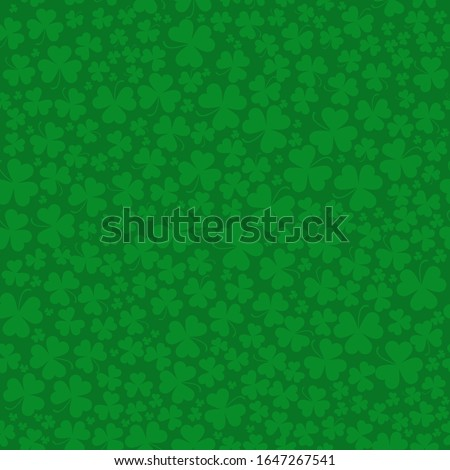 Seamless vector clover background for St. Patrick's Day pattern. Green clover leaves of different sizes and shapes are collected in a seamless pattern. Seamless pattern with the symbol of Ireland  #1647267541
