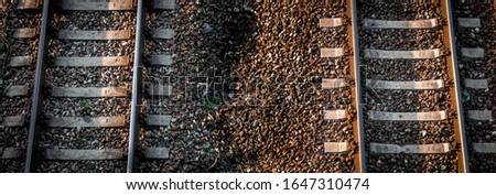 Aerial picture of a two railway tracks side by side.
