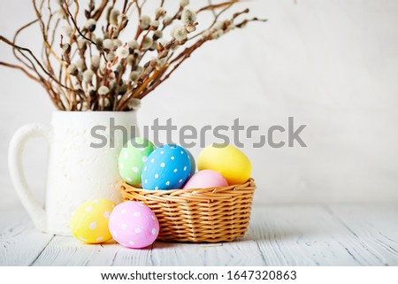 Happy Easter. Congratulatory easter background. Easter eggs and flowers. Background with copy space. Selective focus. #1647320863