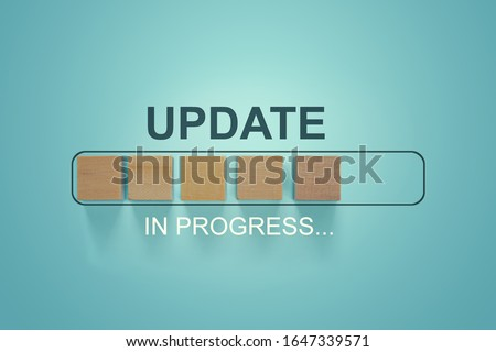 Wooden blocks with the word UPDATE  in loading bar progress. Business concept for act updating something someone or updated version program. #1647339571
