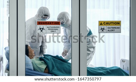 coronavirus covid 19 infected patient in quarantine room with quarantine and outbreak alert sign at hospital with coronavirus covid 19 disease control experts make coronavirus disease treatment Royalty-Free Stock Photo #1647350797