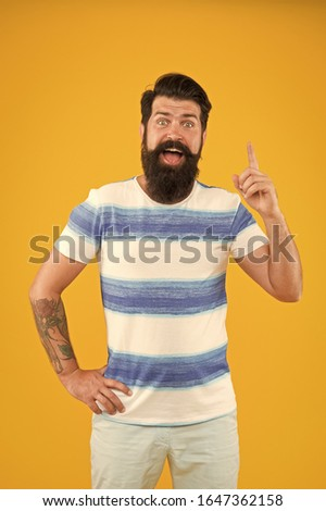 Man bearded hipster with mustache and long beard on yellow background.   #1647362158