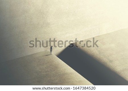 man thinking about taking big risk to reach the other side with a big jump #1647384520