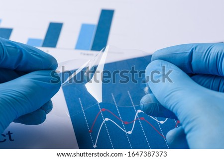 Scientist show layer of novel transparent flexible thin film research in laboratory Royalty-Free Stock Photo #1647387373