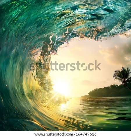 Tropical sunset background. Beautiful colorful ocean wave crashing closing near sand beach with palm tree Royalty-Free Stock Photo #164749616