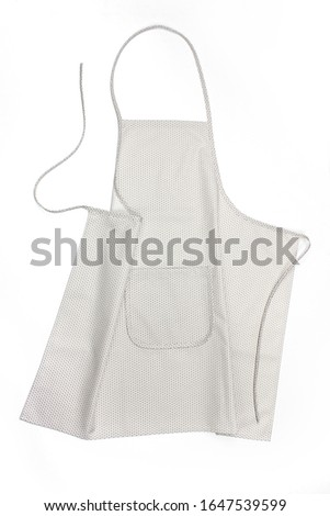 bright apron with a pocket, on a white background. apron for working in the kitchen. #1647539599