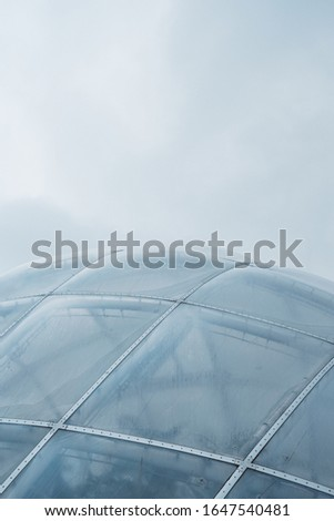 A closeup shot of a glass dome framed with white metals #1647540481