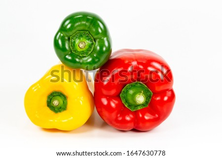 red, green and yellow capsicum fruit illustrating a healthy lifestyle isolated on white background #1647630778