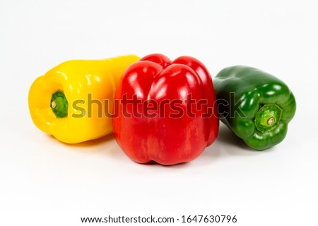 red, green and yellow capsicum fruit illustrating a healthy lifestyle isolated on white background #1647630796