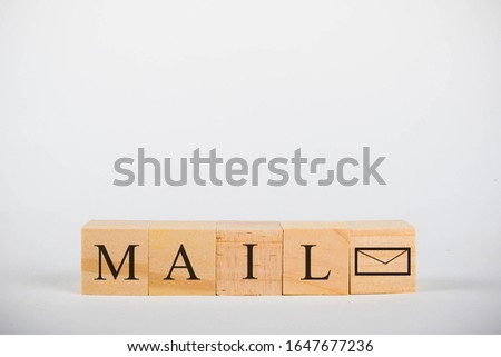 Wooden cubes with lettering spelling Mail with an envelope symbol #1647677236