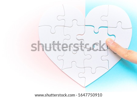Heart shape puzzle on pink and blue background. Image of both thoughts. The last piece of the Heart shape puzzle. #1647750910