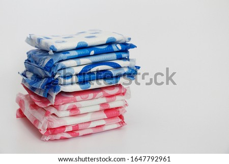 A lot of feminine sanitary pads in the package. Gaskets are stacked on top of each other. Gaskets for monthly use. Hygiene. #1647792961