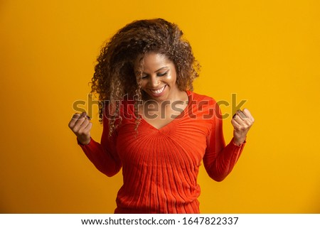 beautiful afro woman celebrating, celebrating, yes. Success concept #1647822337