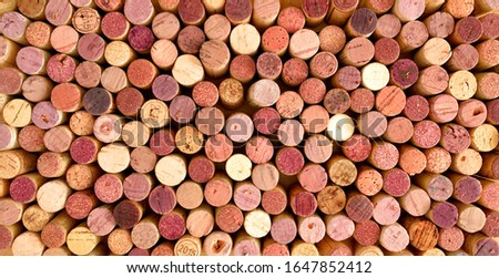Very high resolution photo of original, used corks of red wine. Only generic French texts (regions, produced in castle etc.) are kept, all specific terms were removed.