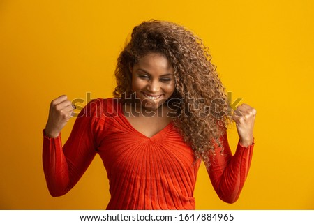 beautiful woman celebrating, celebrating, yes. Success concept #1647884965