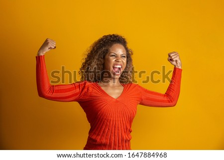 beautiful woman celebrating, celebrating, yes. Success concept #1647884968