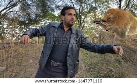 Lion Attack on Man. A Lion attacking the man in a jungle. Forest photograph of a lion attacking on a man from behind. Lion Attack, Tiger Attack. Wildlife animal attacking the man. Wild Animal hunting. #1647971110