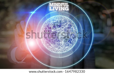 Writing note showing Mindful Living. Business photo showcasing Having a sense of purpose and setting goals in life Elements of this image furnished by NASA. #1647982330