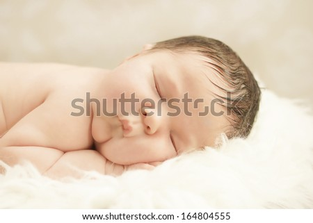 Healthy newborn baby in a contented sleep. Lots of hair and fair skin. #164804555