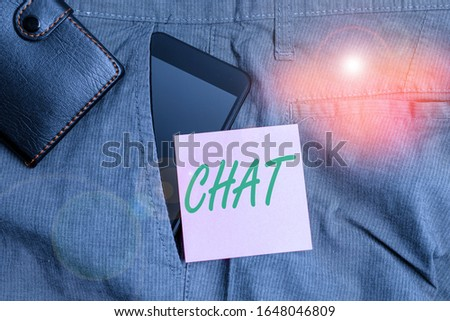 Handwriting text Chat. Concept meaning take part in a discussion that involves sending messages over internet Smartphone device inside trousers front pocket with wallet and note paper. #1648046809