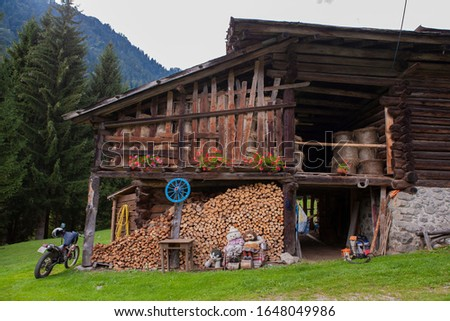 Mountain farm in the Alps, wooden rustical house. #1648049986