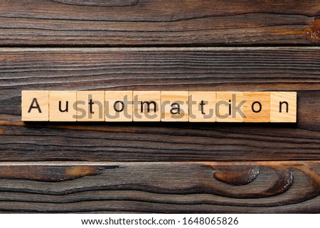 Automation word written on wood block. Automation text on wooden table for your desing, concept. #1648065826
