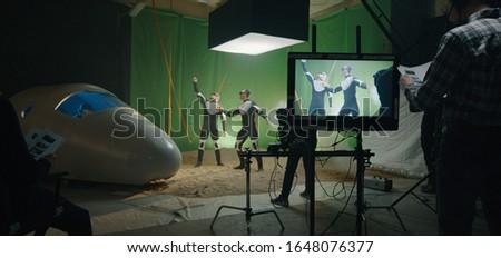 Medium shot of a director scolding an actor for failing scene