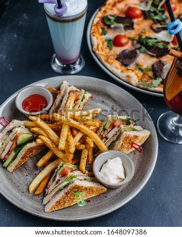 Club sandwich with pizza background and french fries #1648097386