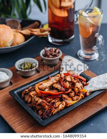 Chicken fajitas and drinks with wooden plate #1648099354