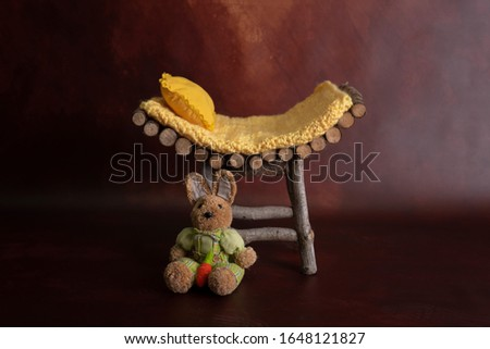 wooden cradle and bunny for photography
