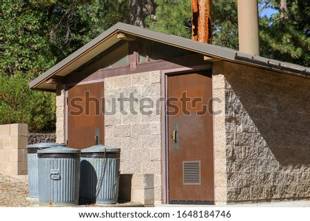 Public outdoor restrooms at lake fulmor. #1648184746