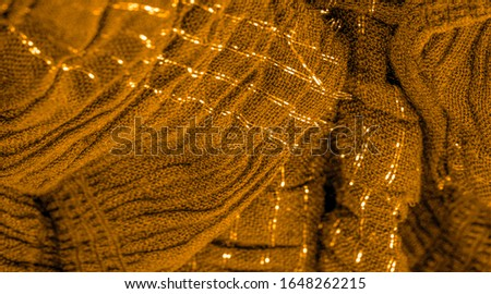 The texture of the background pattern, ornament decor, golden yellow corrugated fabric, fabric with parallel or diagonal folds of serrated folds; products from such a fabric. #1648262215