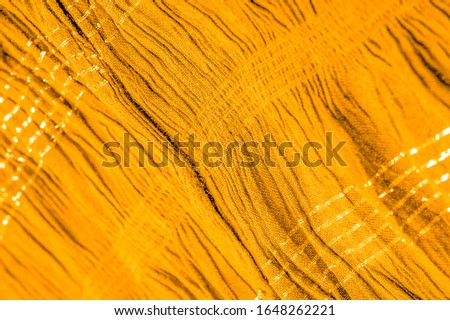 The texture of the background pattern, ornament decor, golden yellow corrugated fabric, fabric with parallel or diagonal folds of serrated folds; products from such a fabric. #1648262221