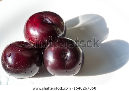 Plum Fruit tree with small juicy edible fruits, which have a large bone,. an oval fleshy fruit that is purple, reddish, or yellow when ripe and contains a flattish pointed pit. #1648267858