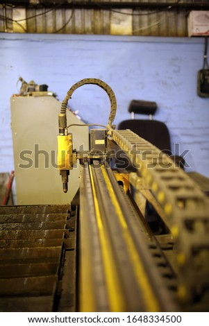 The machine is yellow. Industrial Zone. Automation and industry. #1648334500