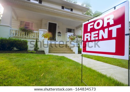 Home For Rent Sign in Front of Beautiful American House