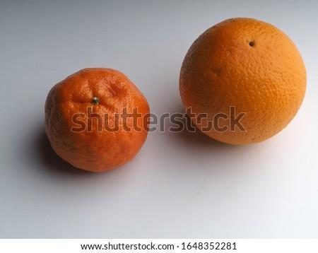 Ripe orange and ripe large mandarin isolated on white background  #1648352281