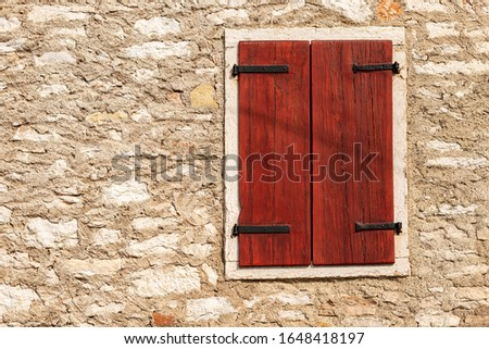 Close-up of a window with closed wooden shutters on a stone wall. Veneto, Verona province, Italy, Europe #1648418197
