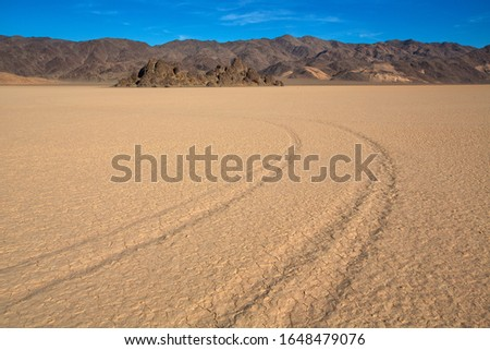 "view of The Racetrack Playa, or The Racetrack, is a scenic dry lake feature with ""sailing stones"" that inscribe linear ""racetrack"" imprints. #1648479076"