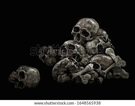 Pile of Skulls Genocide, Black background #1648565938