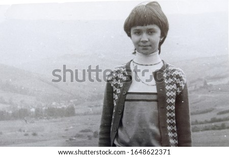 USSR, WESTERN UKRAINE, CARPATHIAN MOUNTAINS - CIRCA 1982: Vintage photo of young girl Inna Tsyukevitch on mountain landscape in Western Ukraine, USSR #1648622371
