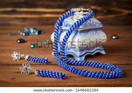 Necklace made of small beads set with handmade earrings. Blue bead decoration #1648682284