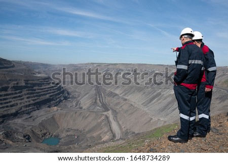Miners at the lookout in a coal mine. Mining #1648734289