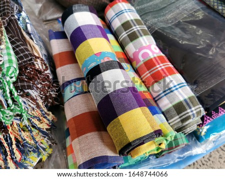 Pile of loincloth sale at the shop, close up traditional Thai craft clothes for Thai male use it in showering, colorful design in modern style, Thai design handicraft.It's a cheap souvenir.