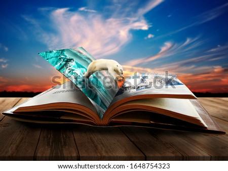 Polar bear jumps out of a book